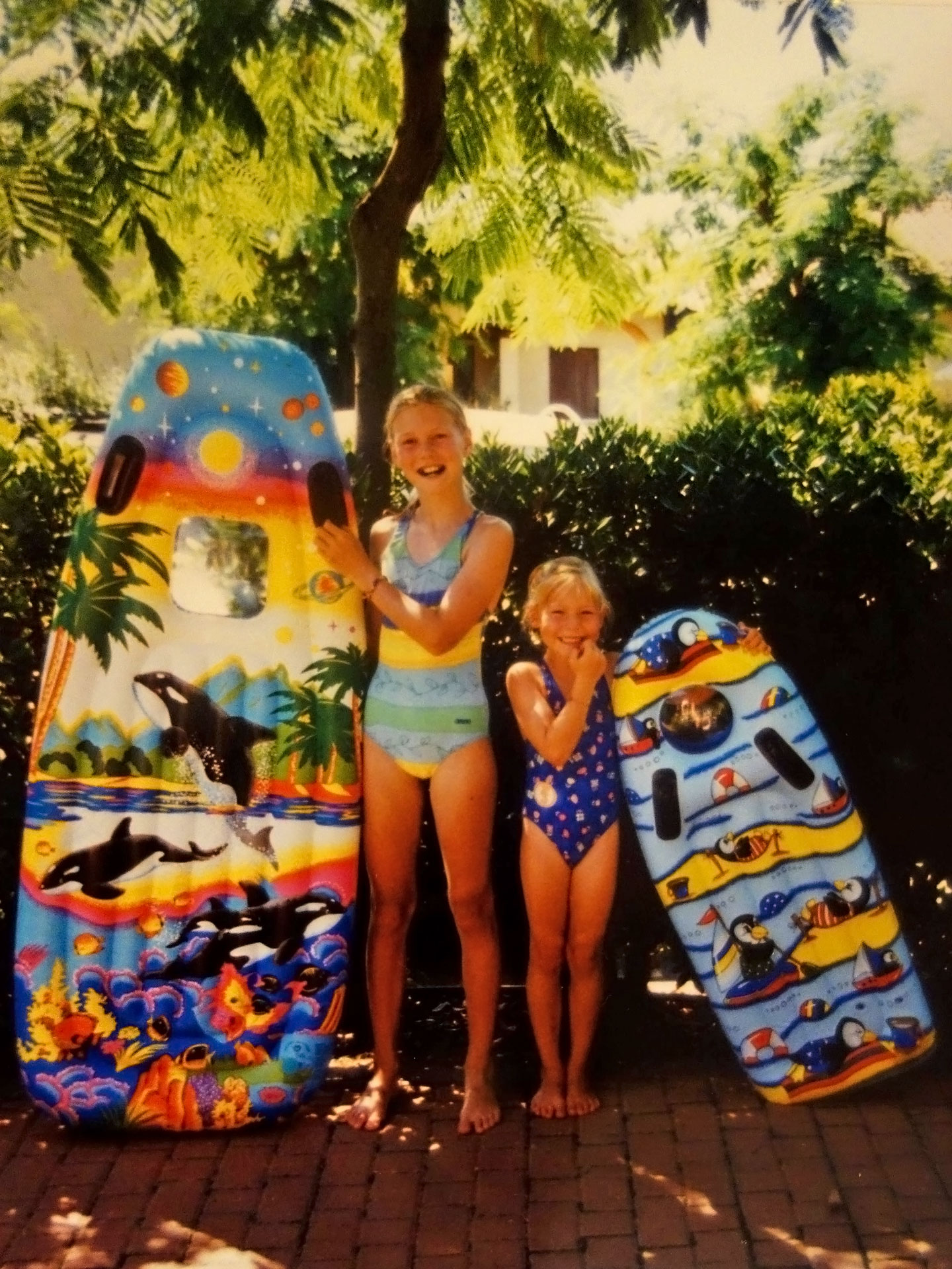 Old picture of sisters with their colorful floating mattresses