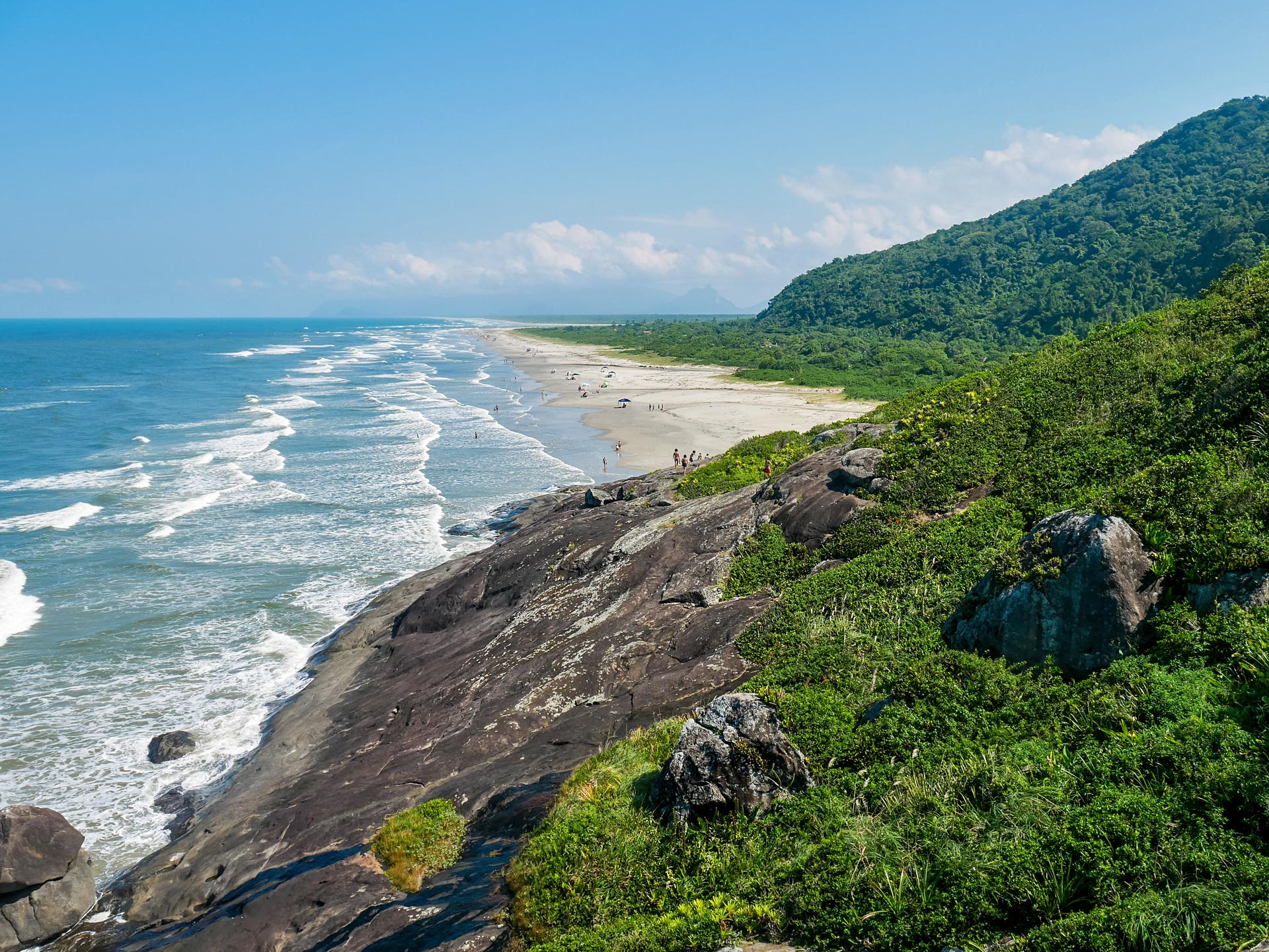 Ocean, beach, cliffs, green mountains of Barra do Una, Brazil