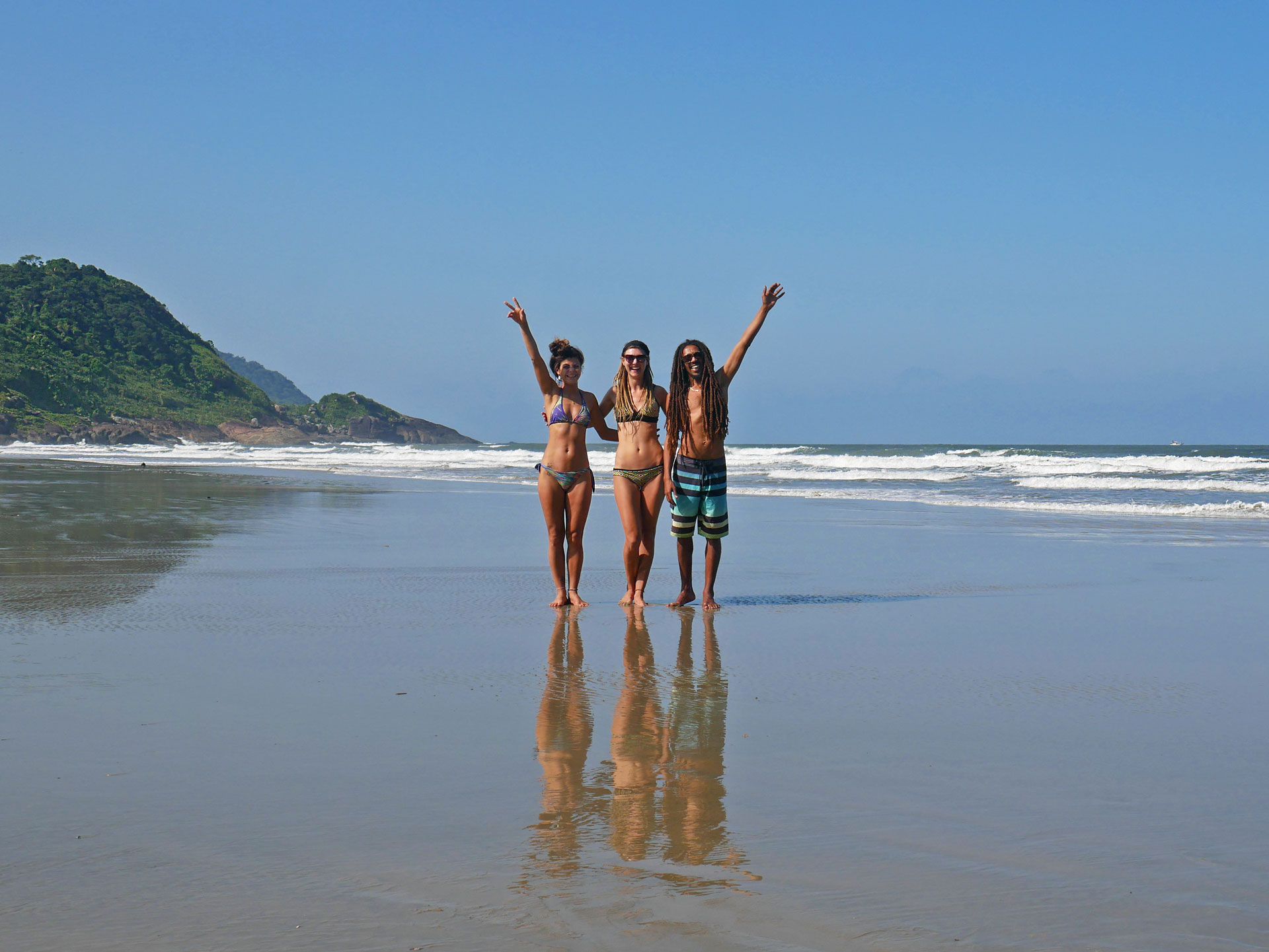 Rasta couple with friend at beach in Barra do Una, Brazil