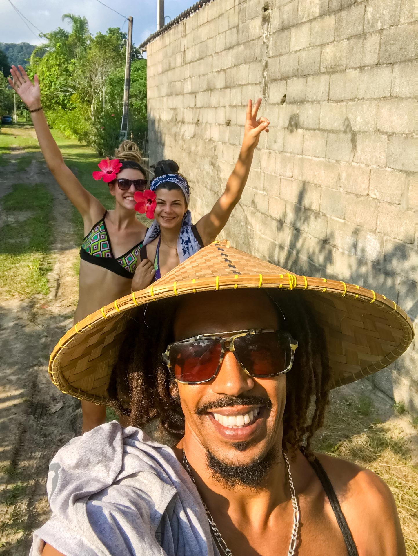 Rasta couple with local friend in Barra do Una, Brazil