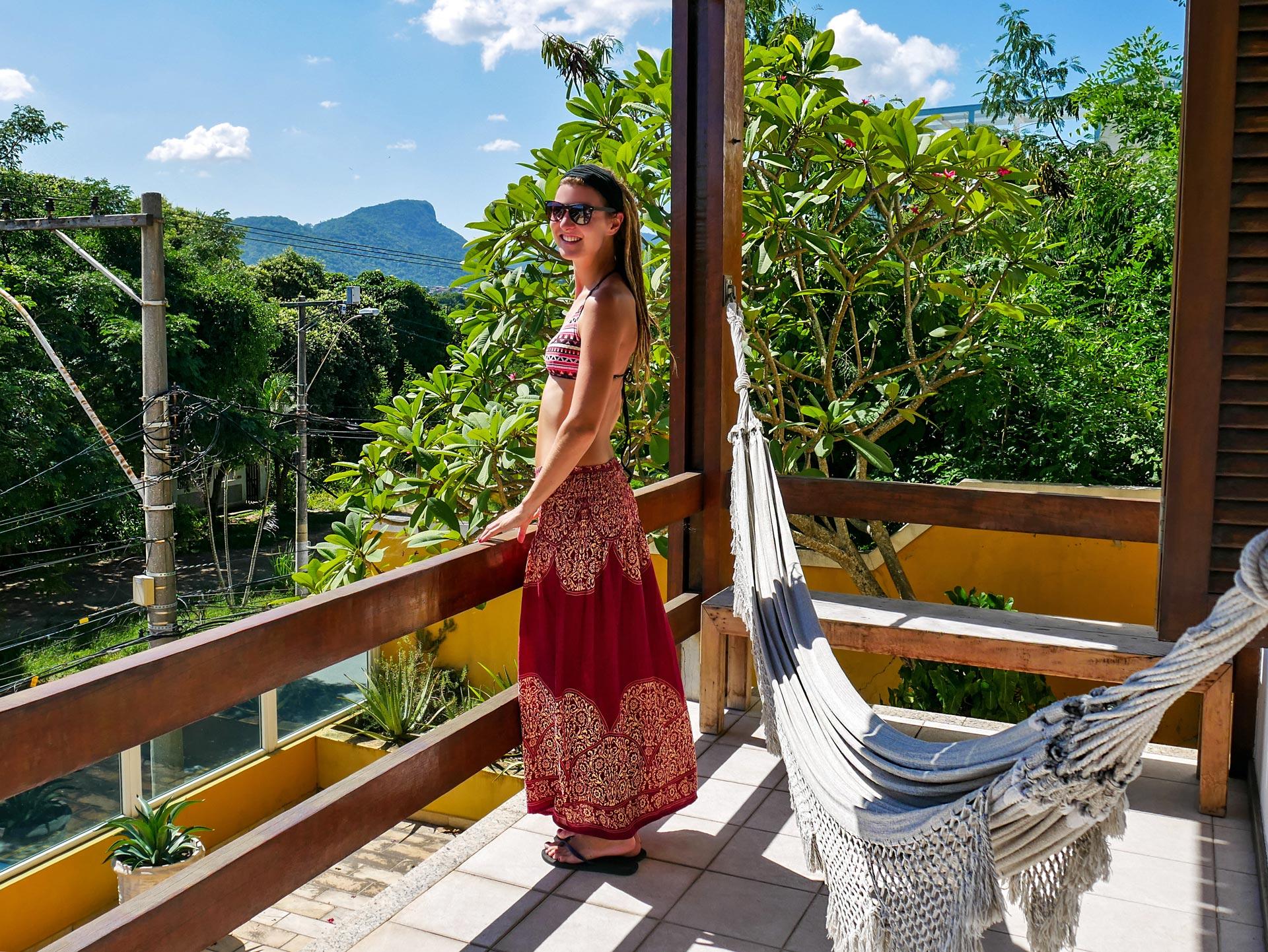 Rasta girl on balcony with hammock and nature view in Niterói, Brazil