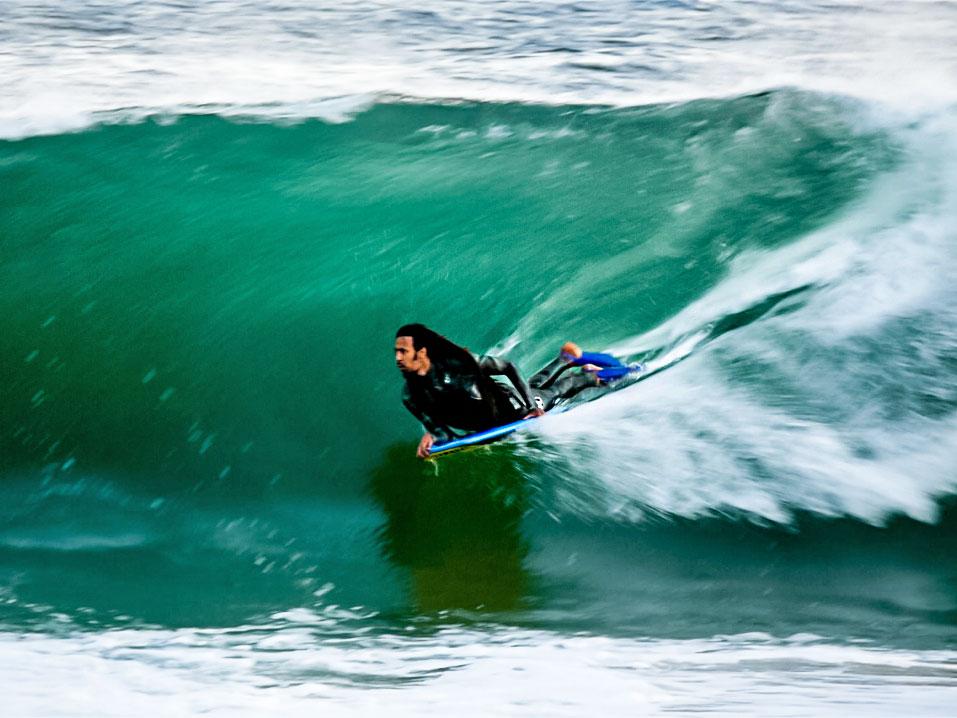 Bodyboarder surfing in Itacoatiara, Brazil