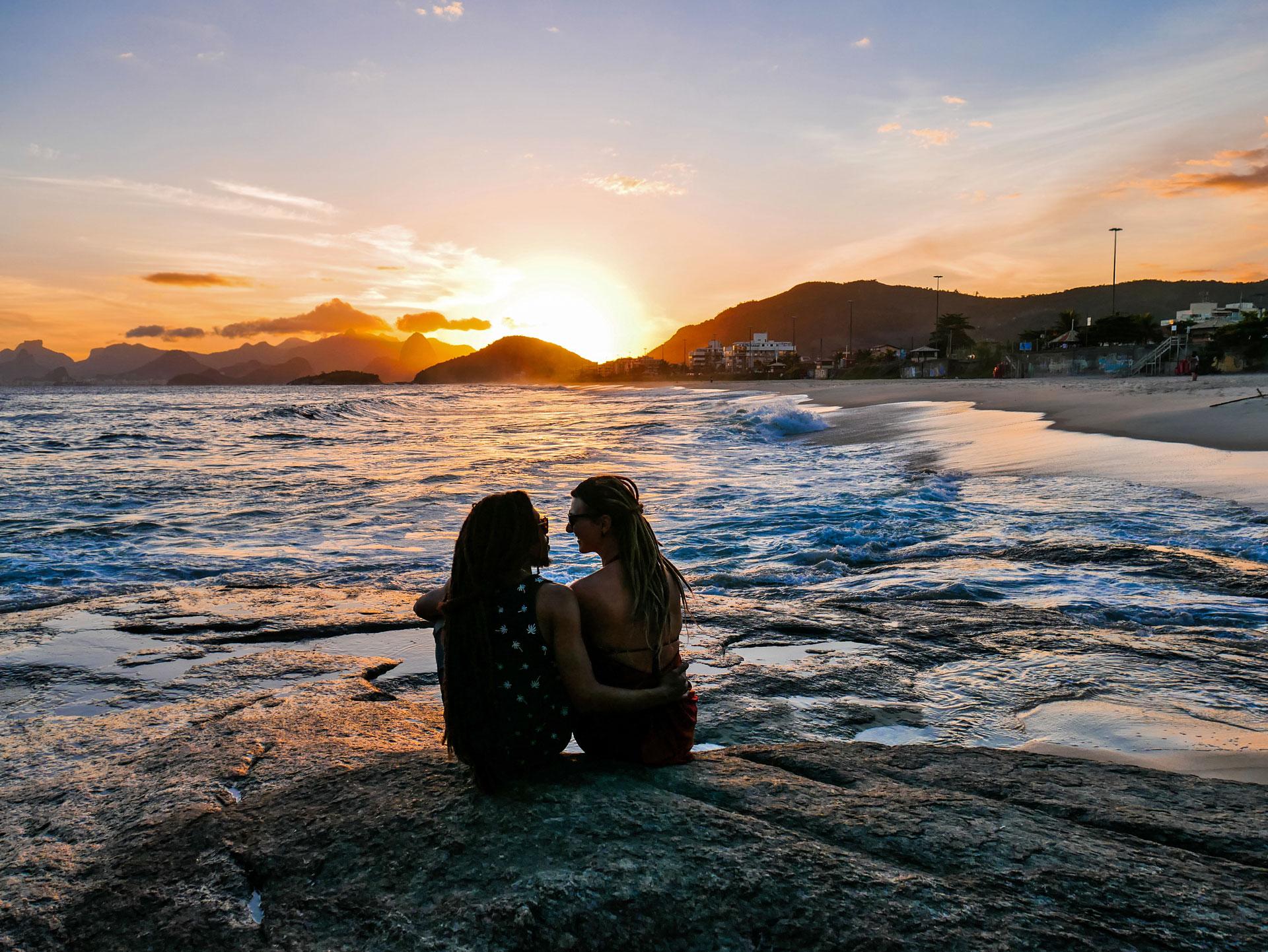 Rasta couple at Piratininga beach during sunset in Niterói, Brazil