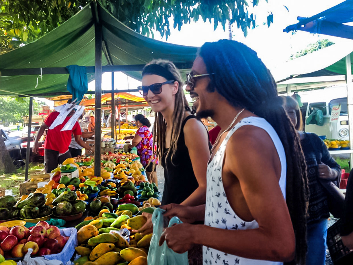 Dreadlock couple shopping at local farmer's market in Peruíbe, Brazil