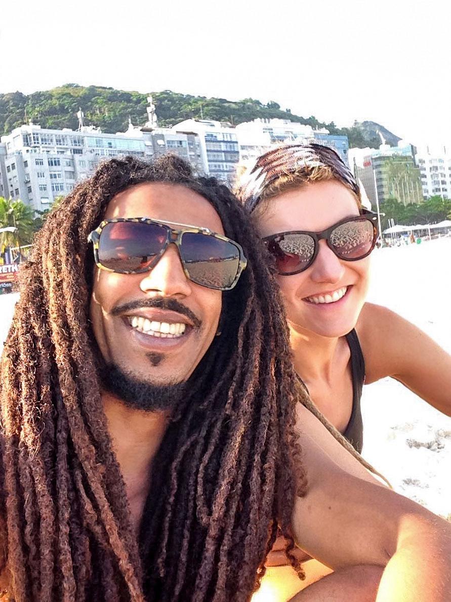 Rasta couple at Leme beach in Rio de Janeiro, Brazil