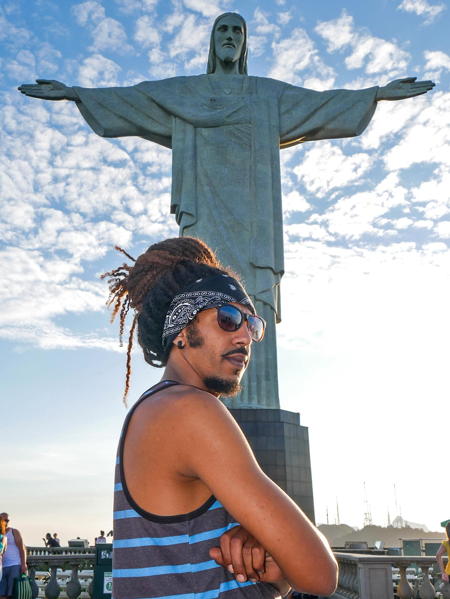 Rastaman in front of Christ the Redeemer in Rio de Janeiro, Brazil