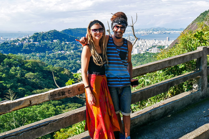 Dreadlock couple on Corcovado mountain in Tijuca Forest National Park overlooking Rio de Janeiro, Brazil