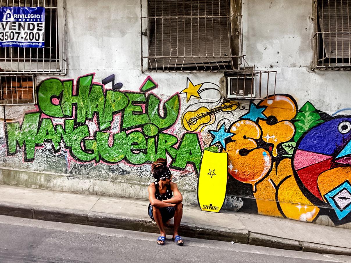 Rastaman in front of graffiti in favela in Rio de Janeiro, Brazil