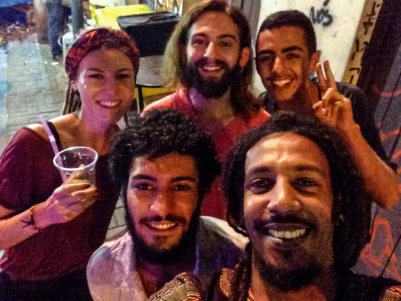 Rasta couple with friends at street party in Rio de Janeiro, Brazil