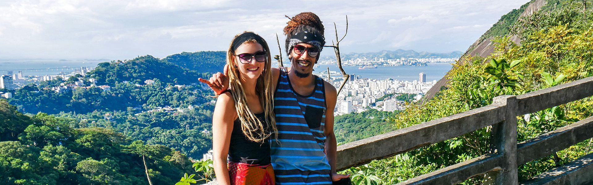 Rasta couple on Corcovado mountain in Tijuca Forest National Park overlooking Rio de Janeiro, Brazil