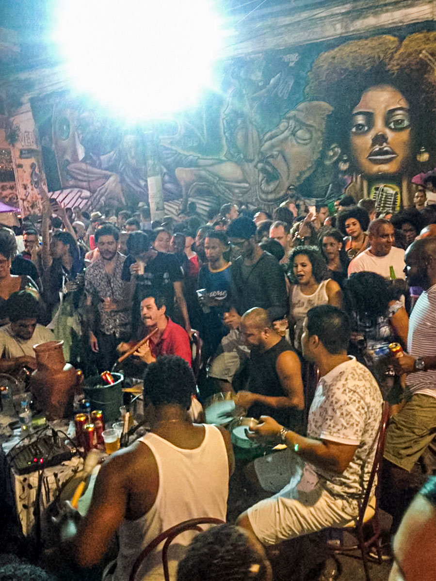 People and musicians at street party at Pedra do Sal in Rio de Janeiro, Brazil