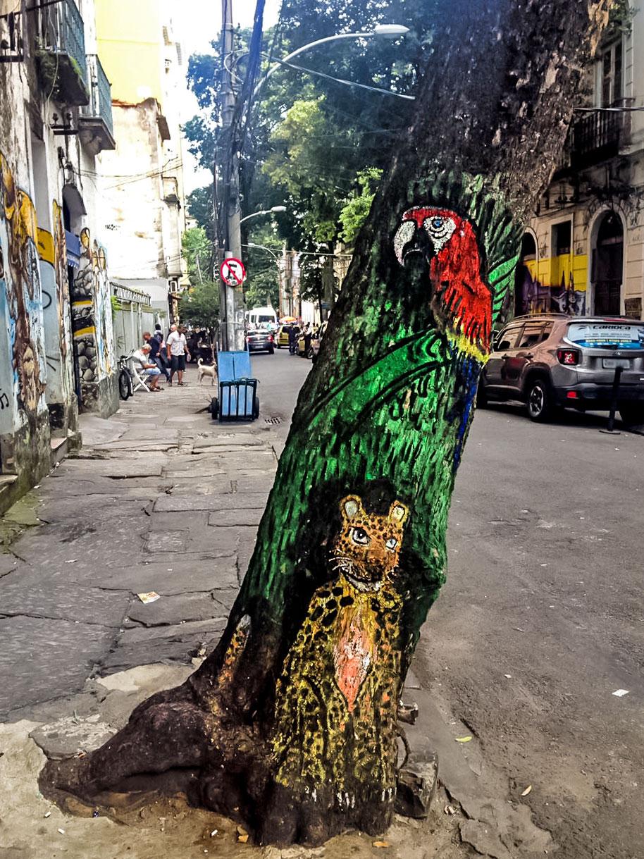 Graffiti of parrot and leopard on tree in Rio de Janeiro, Brazil