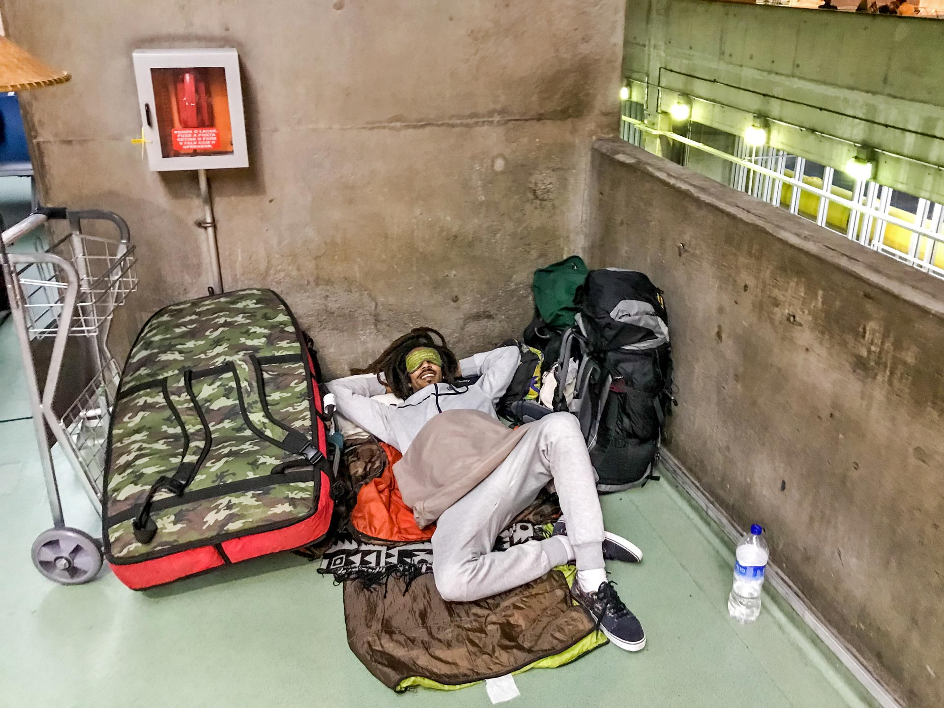 Rastaman spending night at bus terminal in São Paulo, Brazil