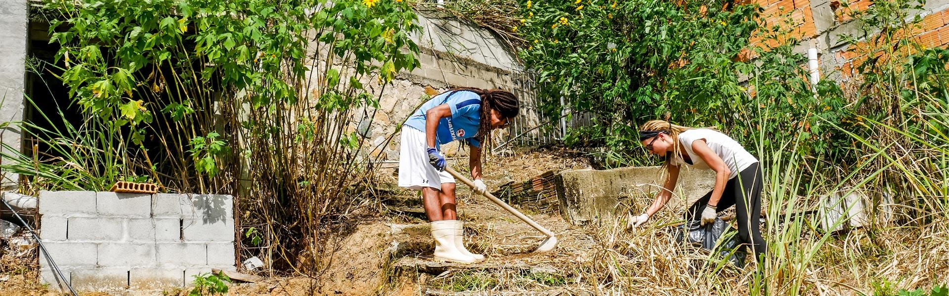 Rasta couple working in garden in Florianópolis, Brazil