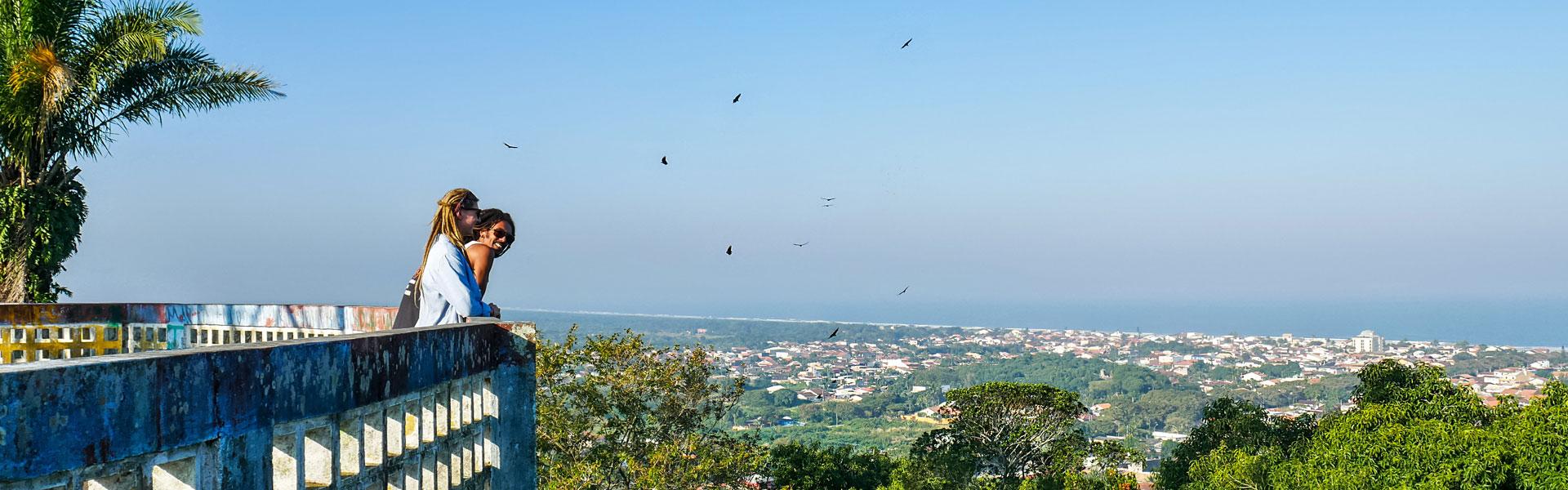 Rasta couple overlooking Peruíbe, Brazil, from Mirante da Torre