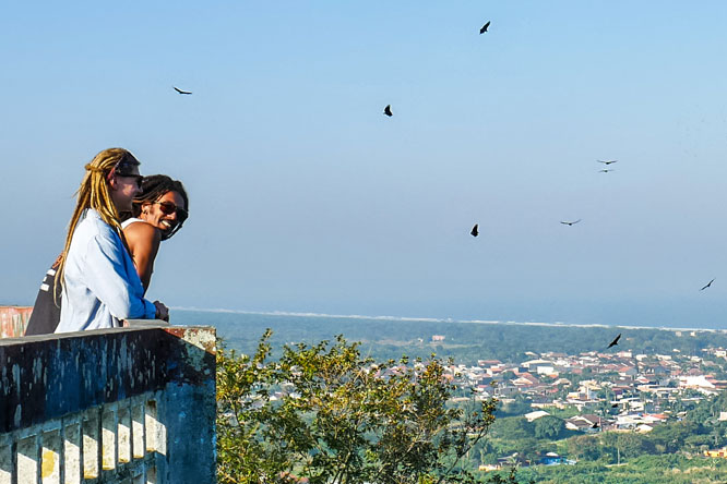 Travel couple overlooking Peruíbe, Brazil, from Mirante da Torre