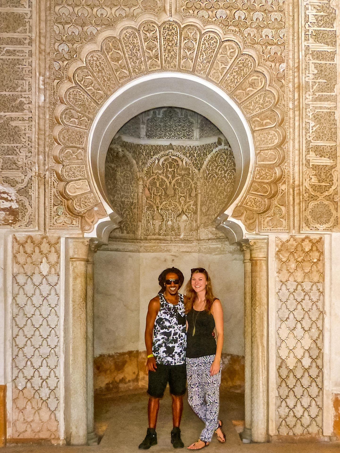 Travel couple in madrasa in Marrakesh, Morocco