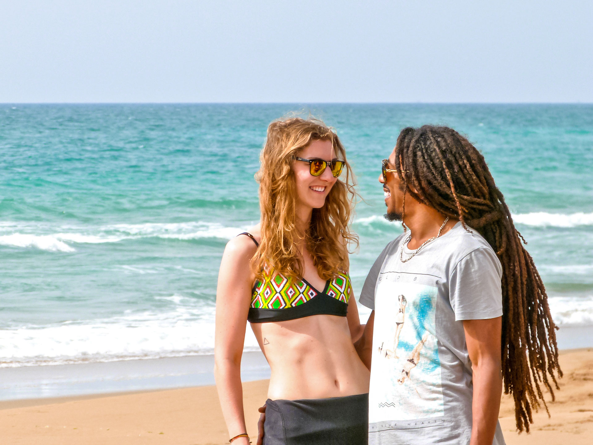 Travel couple at beach in Moulay Bouslham, Morocco