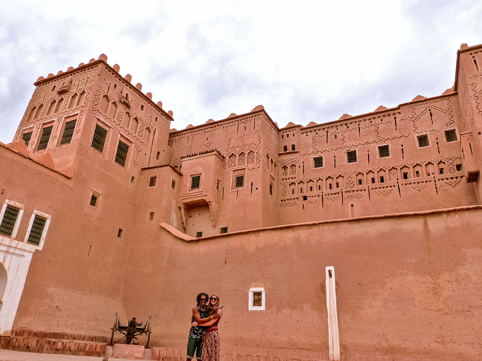 Travel couple in Taourirt Kasbah in Ouarzazate, Morocco