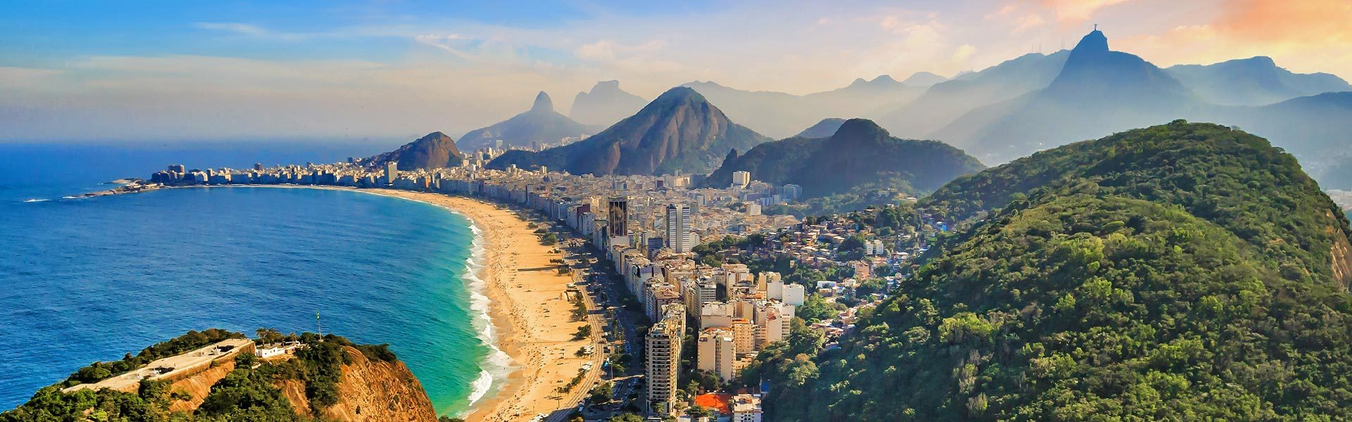 Aerial view of Copacabana with ocean, beach, mountains and buildings in Rio de Janeiro, Brazil